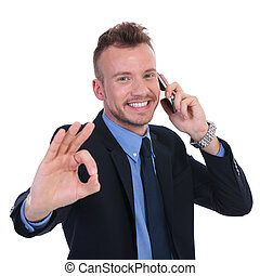 business man on the phone shows ok - young business man...