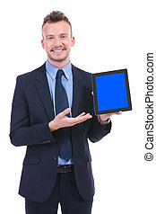 business man presents a tablet with a smile - young business...