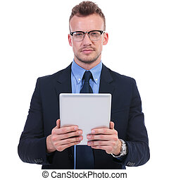 business man holds a tablet