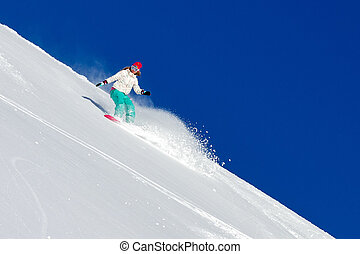 Steep slopes woman - Female snowboarder in fresh powder on a...
