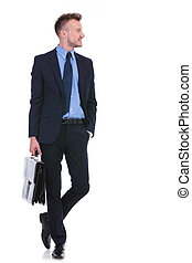 business man with suitcase and hand in pocket - full length...