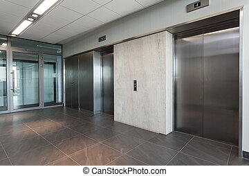 Elevators - Shining silver elevator in a modern office...