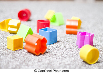 colorful toy blocks on a carpet