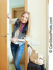 Blonde woman with luggage loocking door - Blonde positive...