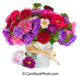 bouquet of aster flowers in pot - bouquet of red and violet...