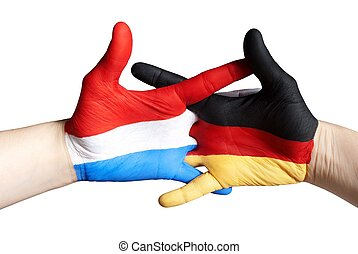 dutch german relation - hands symbolizing the relation...