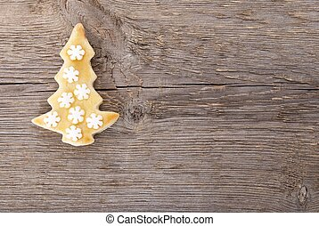 christmas cookie with wooden background - a christmas tree...
