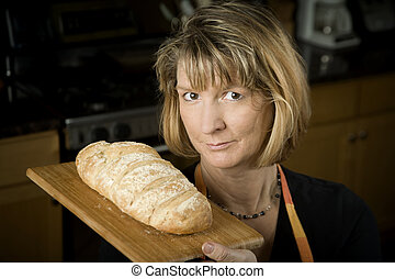 Woman in Kitchen with Bread