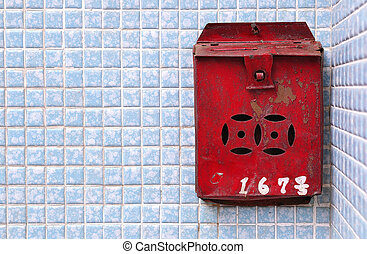 Rusty Chinese postbox on a blue tiled wall, Hong - Rusty...