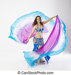 belly dancer woman - woman with curves dancing an oriental...