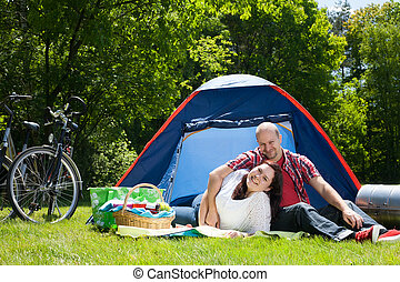 Happy couple on vacation - Happy young couple is relaxing on...