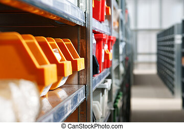 Storage bins and racks in a warehouse. Selective focus on...