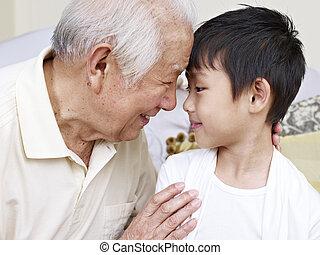 grandpa and grandson - grandpa talking to grandson.