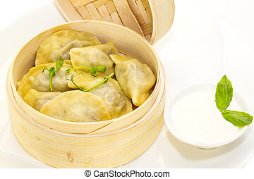 dumplings and sour cream - dumplings with sour cream in a...