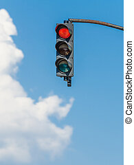 Red Traffic Light On Blue Sky