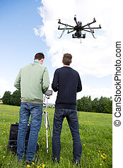 Photographer and Pilot Operate UAV - Photography RC...