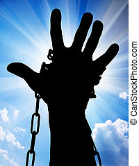slavery and freedom - Hands tied up with chains against blue...