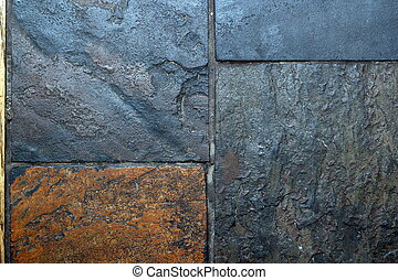 tiles of grungy stone - closeup of textured tiles made from...
