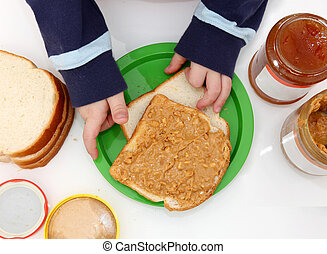 Peanut Butter and Jelly - young child\\\'s hands making...