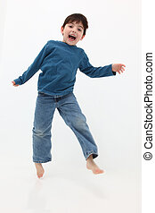 Happy Boy - Adorable happy five year old boy jumping over...