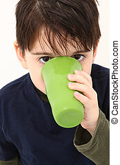 Boy Drinking - Adorable 5 year old boy drinking from green...
