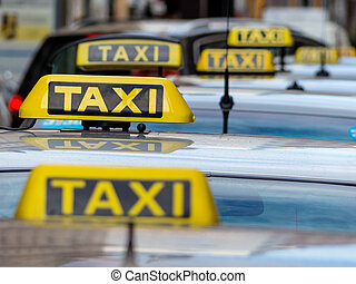 taxis at a taxi rank - taxis wait at a taxi rank, symbol...