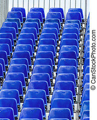 grandstand with blue chairs, symbolic photo for background,...