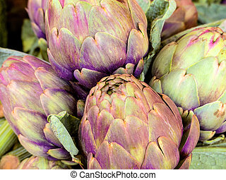 fresh artichokes, background - fresh artichokes on a...