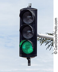 traffic light with green light - a traffic light with green...