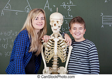 Students with a skeleton - Students are hugging a skeleton...