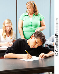 Young Boy Taking Test - Young mixed race student taking a...