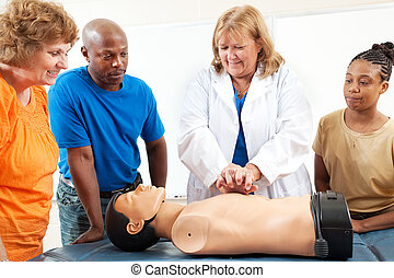 Adult Education Students Learn CPR - A group of adult...
