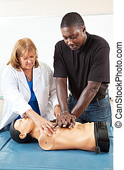 Adult Education - Teaching CPR - Doctor or nurse instructs...