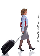 Female business woman with travel suitcase - A businesswoman...