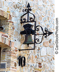 bell on a house wall