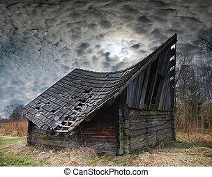 old hayloft - Old Hayloft under dark dramatic skies, wavy...