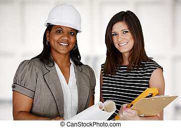 Construction Team - Group of people working at a...