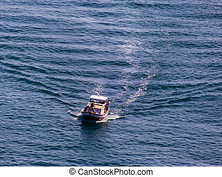 fishing boat on the way to the sea, symbolic photo for...