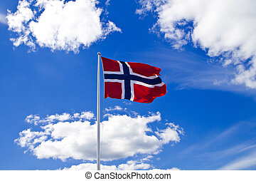 Norwegian flag on blue sky and clouds