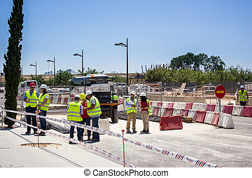 Men to work in the yard - Road construction site with...