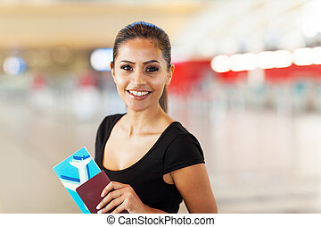 young business woman with passport and air ticket - cheerful...