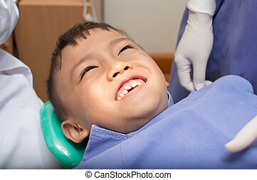 dentist - Asian kid at the dentist clinic.