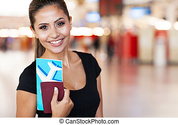 portrait of young businesswoman at airport - close up...