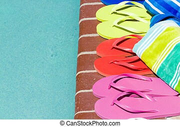 Flip flops - Colorful flip flops by a swimming pool.
