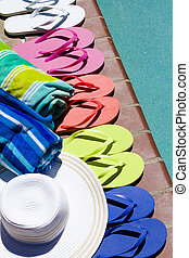Flip flops - Colorful flip flops by a swimming pool
