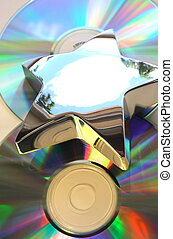 Music star - Reflecting metal star in top of compact disks
