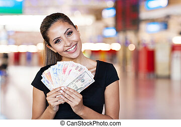 young woman holding cash outside casino - attractive young...