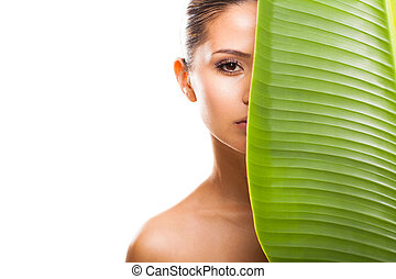 green leaf shading half beautiful woman face