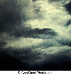 Dark sky with clouds in blue and black tones
