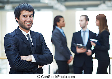 Smart boss - Portrait of friendly male leader looking at...